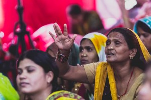 A Northern Indian woman prays at the 2014 I Thirst For You Conference in Lucknow, Uttar Pradesh, India.